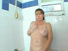 Busty horny mom rubbing her...